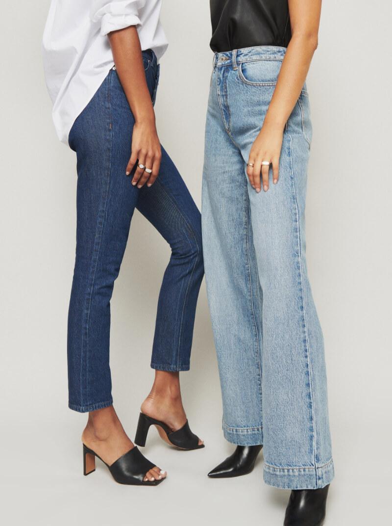 Two models wearing blue jeans.
