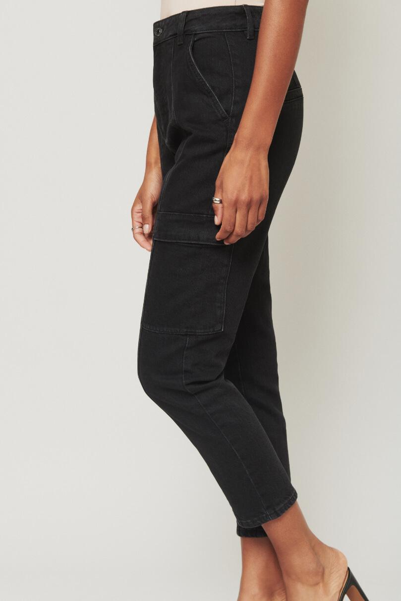 Model is wearing ankle length black jeans.