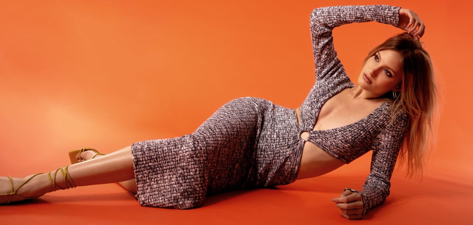 A model wears a knit wrap dress.