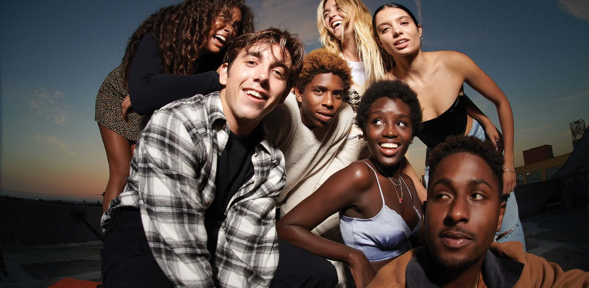 The skateboarding crew Illegal Civ as well as Tavia, Sparkle, Crystal, and Ganna pose on a rooftop for the Garage Fall 2021 campaign.