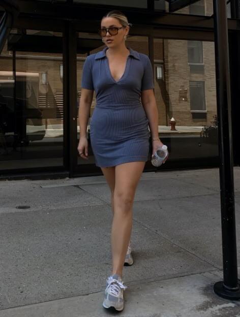 Model is wearing a navy blue polo dress.