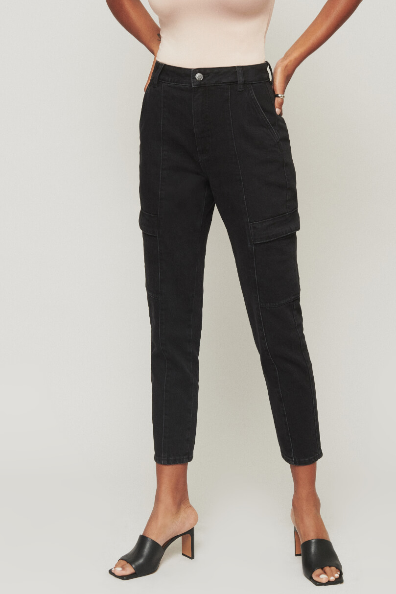 Model is wearing black carrot jeans.